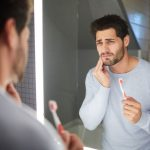 Dental Patient Suffering From Symptomatic Diseases Caused By Gum Disease