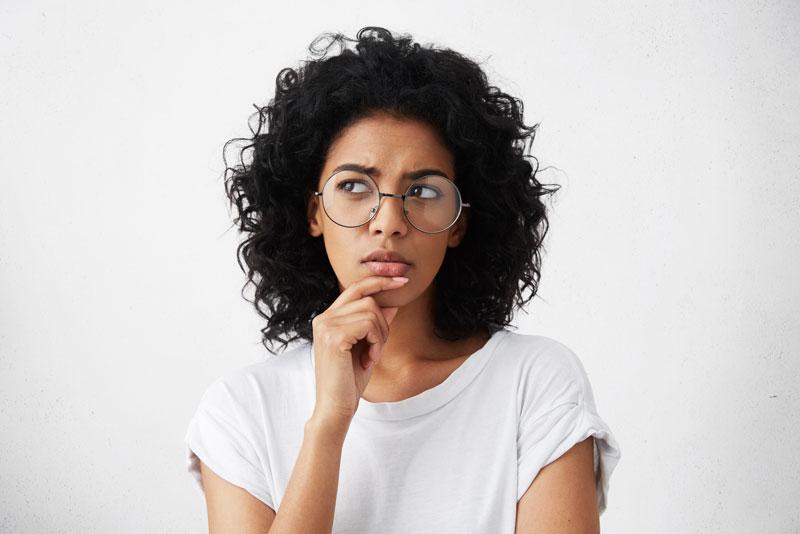 Questioning Dental Patient Wondering About Dental Implant Procedures